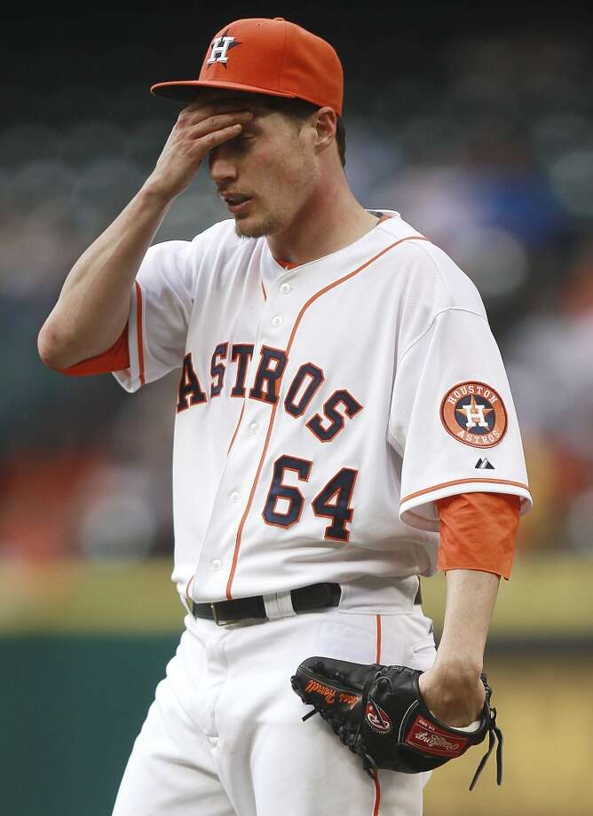 Astros pitcher Lucas Harrell reacts after allowing a home run against the Tigers.