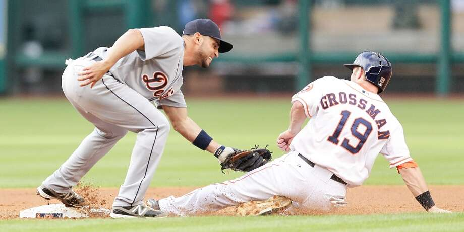 Omar Infante of the Tigers tags out Astros outfielder Robbie Grossman.