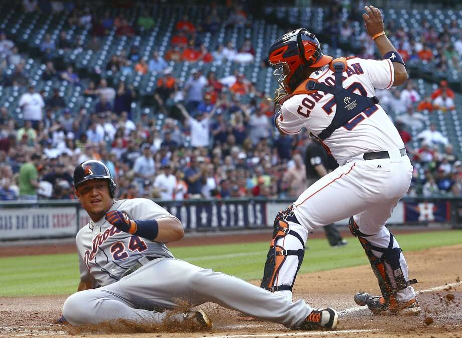 Miguel Cabrera of the Tigers slides in to home base safely against the Astros.