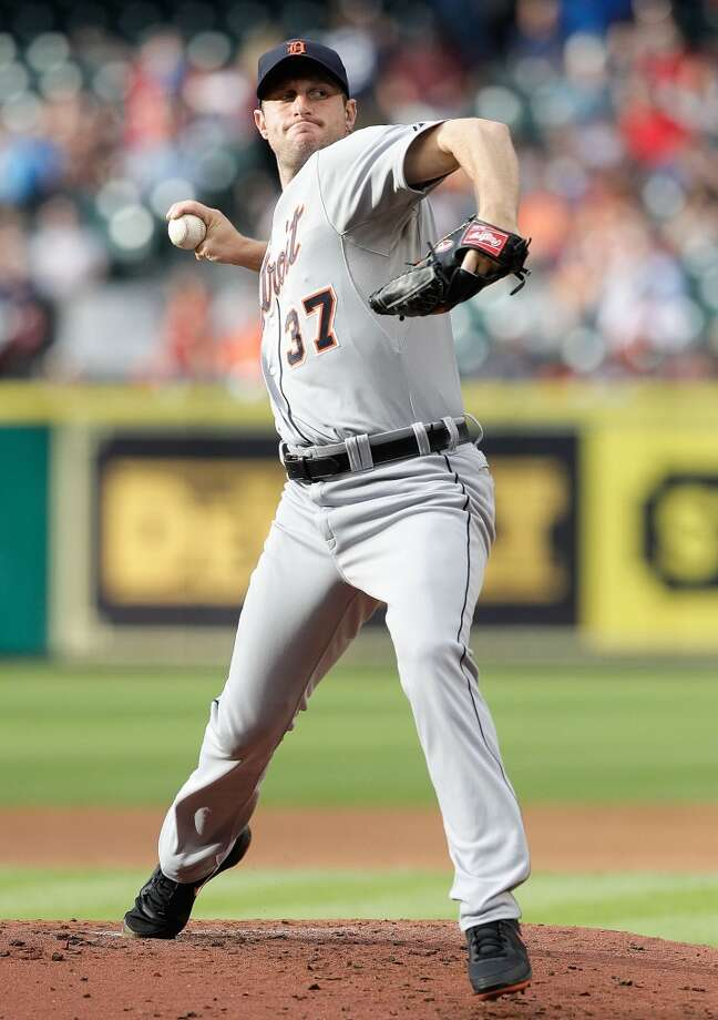Tigers pitcher Max Scherzer makes a throw against the Astros.