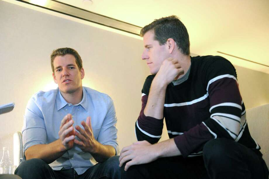 Tyler, left, and Cameron Winklevoss speak about their stories and thoughts on building a successful company with other business leaders, at J House Hotel, in Greenwich, Conn., Thursday, May 2, 2013. The international law firm Withers Bergman hosted the Winklevosses as participants of the firmâÄôs âÄúInside the Entrepreneurial MindâÄù series. Photo: Helen Neafsey / Greenwich Time
