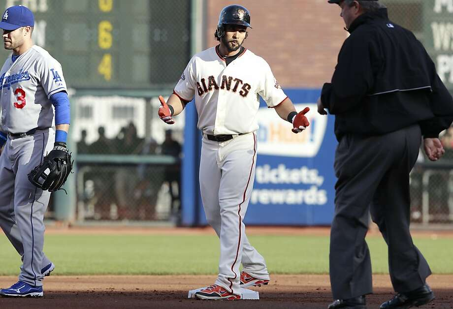 The Giants' Angel Pagan, (16) takes a double in the first inning after a fielding error by the Dodgers short stop Dee Gordon, (9), as the San Francisco Giants take on the Los Angeles Dodgers at AT&T Park in San Francisco, Calif., on Saturday May 4, 2013. Photo: Michael Macor, The Chronicle