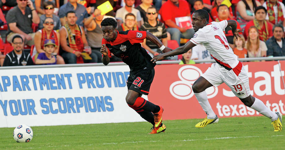 Walter Ramirez streaks past Borfor Carr as the Scorpions play the Atlanta Silverbacks at Toyota field on May 4, 2013. Photo: TOM REEL