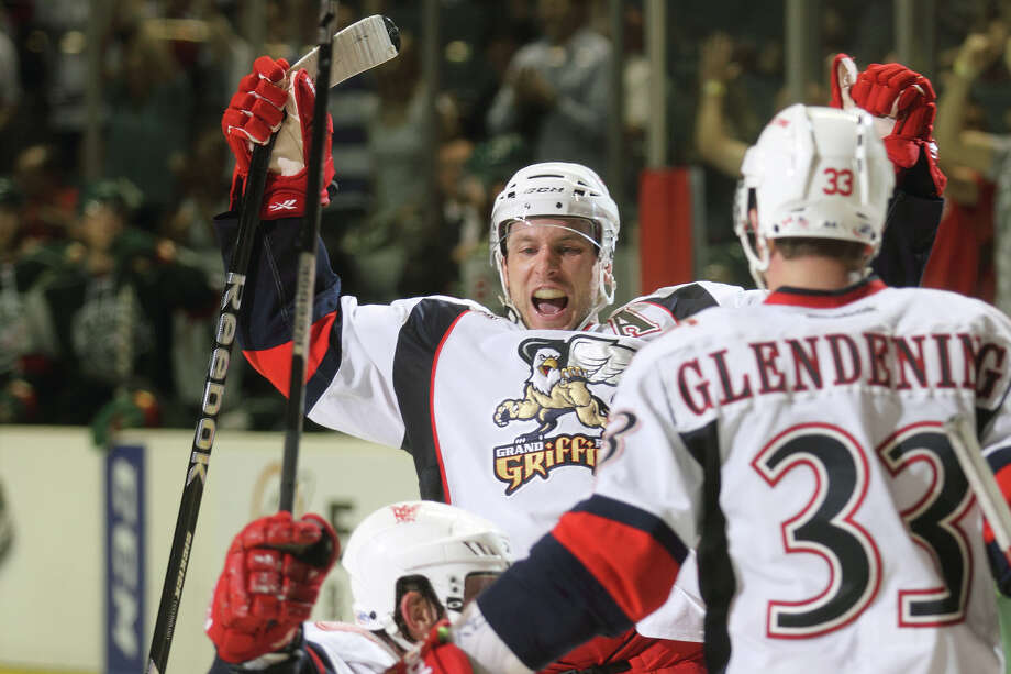 Nathan Paetsch, left, and Luke Glendening engage in one of seven goal celebrations by the Griffins on Saturday night against the Aeros. Photo: Mark Newman / All Rights Reserved
