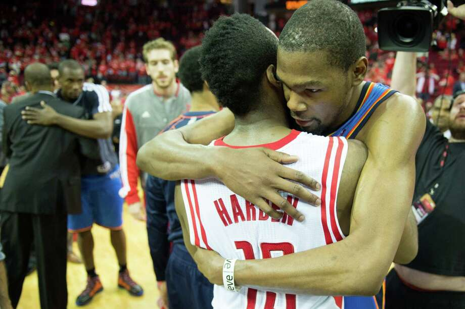 Rockets guard James Harden, left, shares a moment with Thunder forward and ex-teammate Kevin Durant after Friday's series finale. Photo: Smiley N. Pool, Staff / © 2013  Houston Chronicle