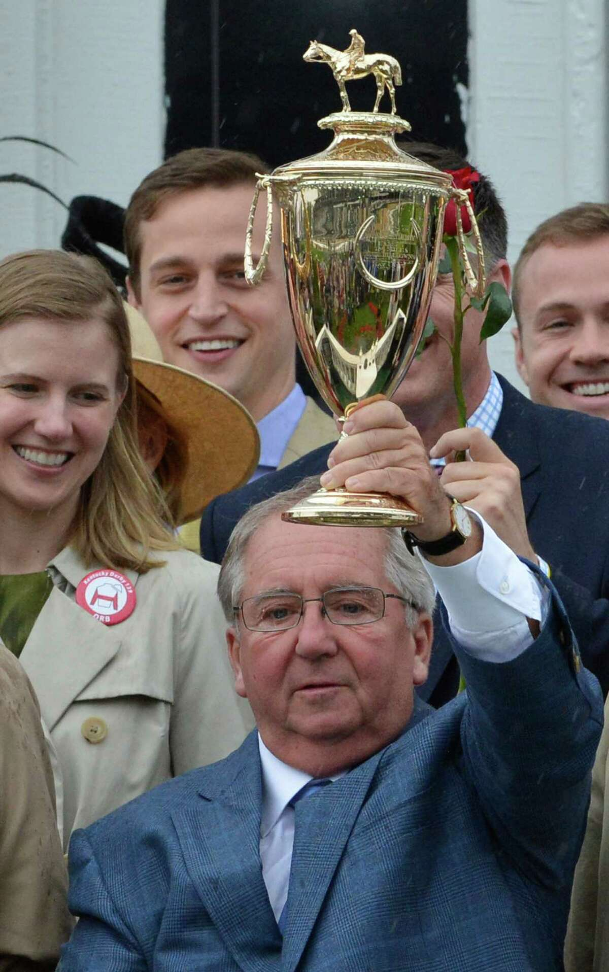 Orb's trainer Shug McGaughey holds up the winner's trophy after his charge won the 139th running of the Kentucky Derby May 4, 2013 at Churchill Downs in Louisville, Kentucky. (Skip Dickstein/Times Union)