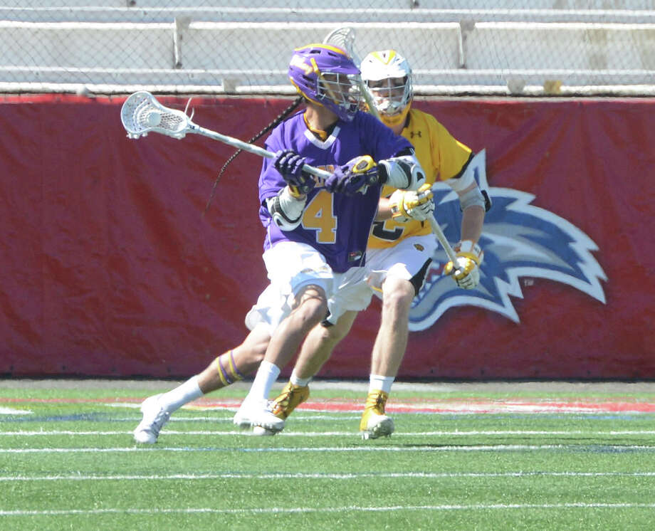 Lyle Thompson of UAlbany makes an offensive move in the America East title game against University of Maryland Baltimore County at Stony Brook's stadium on Saturday, May 4, 2013. (Bob O'Rourke / Special to the Times Union)
