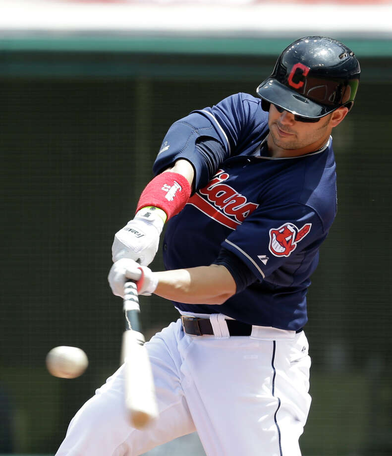 Cleveland Indians' Nick Swisher hits a solo home run off Minnesota Twins starting pitcher Kevin Correia in the first inning of a baseball game, Saturday, May 4, 2013, in Cleveland. (AP Photo/Tony Dejak) Photo: Tony Dejak