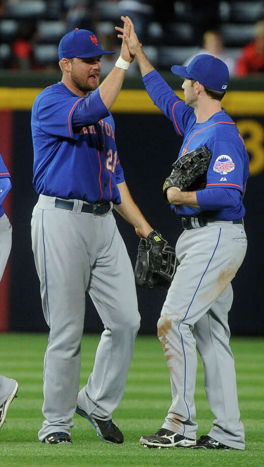 New York Mets left fielder Lucas Duda (21), and right fielder Mike Baxter (23) celebrate after playing the Atlanta Braves during a baseball game, Friday, May 3, 2013, in Atlanta. New York won 7-5. (AP Photo/John Amis) Photo: John Amis