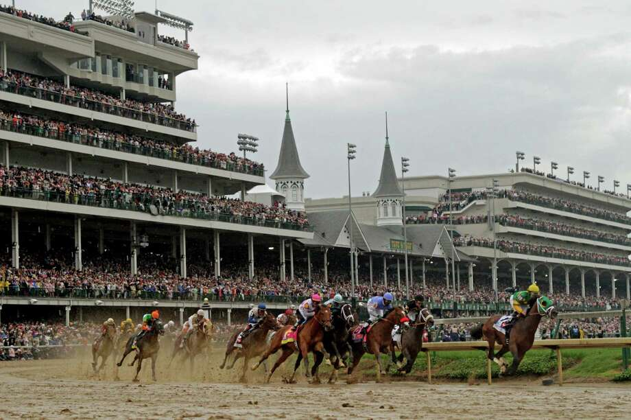 Horses make their way around turn one during the 139th Kentucky Derby at Churchill Downs Saturday, May 4, 2013, in Louisville, Ky. (AP Photo/Darron Cummings) Photo: Darron Cummings, Associated Press / AP
