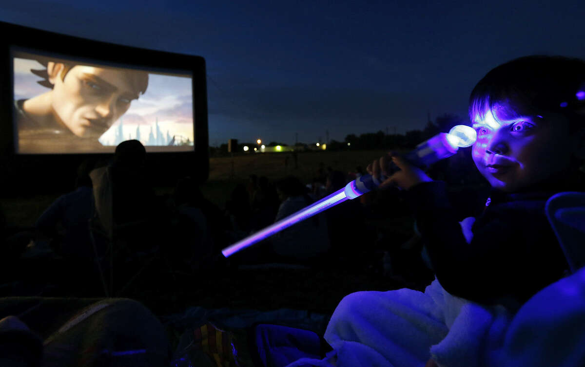 """Aiden Tate, 3, was on hand for the showing of """"Star Wars: The Clone Wars"""" after a ribbon-cutting for the new $2.3 million Mission Marquee Plaza at the former Mission Drive-In site."""