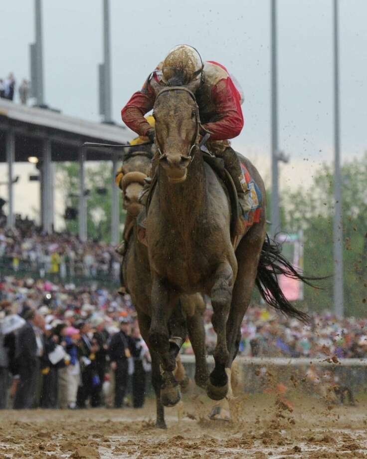 Orb with jockey Joel Rosario in the irons wins the 139th running of the Kentucky Derby May 4, 2013 at Churchill Downs in Louisville, Kentucky.     (Skip Dickstein/Times Union) Photo: SKIP DICKSTEIN