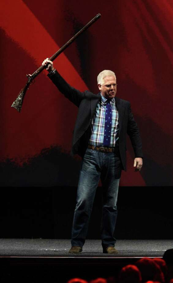 "Gun-control advocates ""feel they must regulate us until we comply,"" political commentator Glenn Beck told the NRA's ""Stand and Fight"" rally. To cheers, he declared: ""I will not comply!"" Photo: Melissa Phillip / Houston Chronicle"