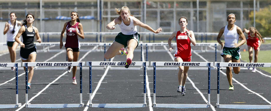 Incarnate Word's Emily Phillips (second from right) leads the way en route to winning the 300-meter hurdles at the TAPPS Class 5A South Region Meet on Saturday. She also claimed the 110 hurdles. Photo: Photos By Edward A. Ornelas / San Antonio Express-News