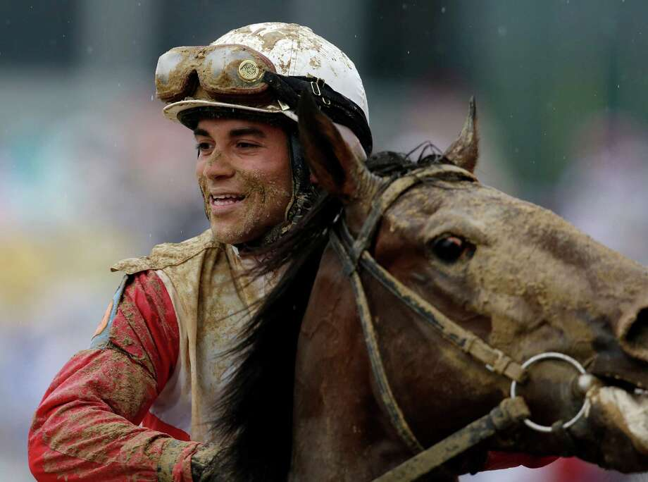 Joel Rosario and morning-line favorite Orb could use a bath after coming from behind on a sloppy track to win the 139th Kentucky Derby by 21/2 lengths. Photo: Darron Cummings, STF / AP