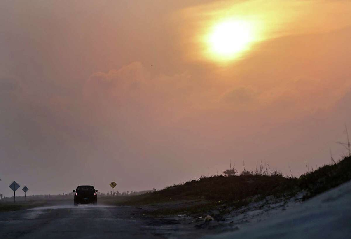 A vehicle leaving Boca Chica Beach travels next to the proposed site of the Space Exploration Technologies Corp. - better known as SpaceX - commercial spaceport facility near Brownsville.