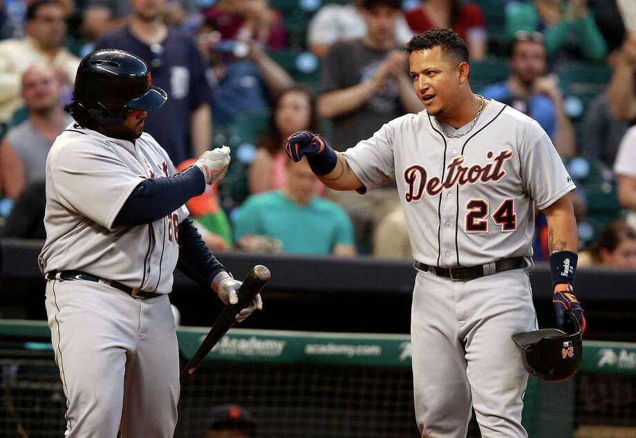 Detroit's Miguel Cabrera, right, is congratulated by Prince Fielder after Cabrera homered in the sixth inning - his second long ball of the game against the Astros. He went 4-for-4 and drove in six runs for the fifth time in his career. Photo: Patric Schneider, FRE / FR170473 AP