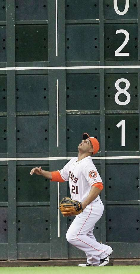 Astros left fielder Fernando Martinez can only watch as a ball hit by the Tigers' Victor Martinez lands in the Crawford Boxes for a ninth-inning home run. Photo: Bob Levey, Stringer / 2013 Getty Images
