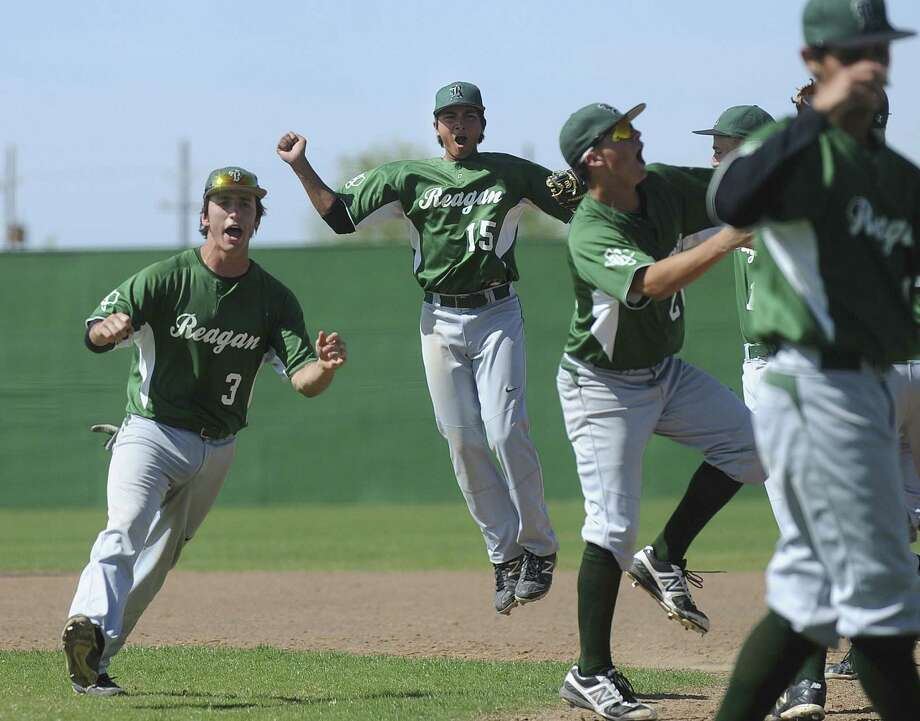 Reagan's Tyler Frick (3), whose line-drive home run sparked an eight-run rally in the seventh inning, celebrates with his teammates after beating Judson. Photo: Billy Calzada / San Antonio Express-News