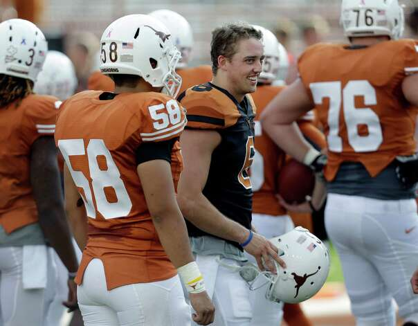 Texas' Case McCoy, center, during the team's spring football game, Saturday, March 30, 2013, in Austin, Texas. (AP Photo/Eric Gay) Photo: Associated Press / AP