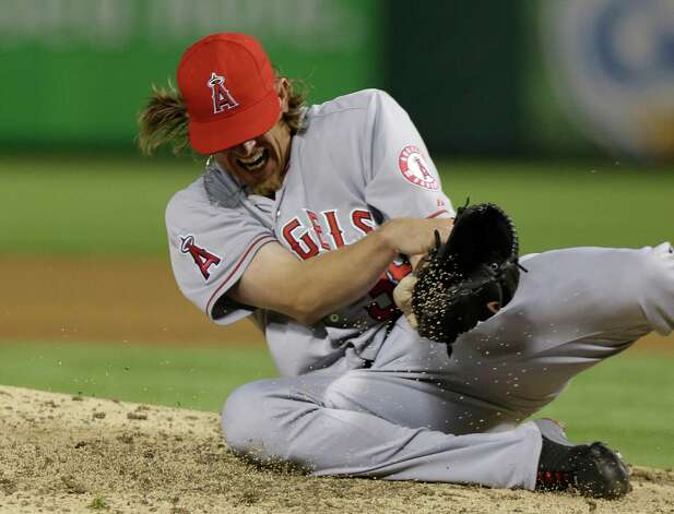 Los Angeles Angels starting pitcher Jered Weaver reacts to getting hit in the arm with a line drive during the sixth inning of a baseball game against the Texas Rangers Sunday, April 7, 2013, in Arlington, Texas.  Weaver left the game. (AP Photo/LM Otero) Photo: Associated Press / AP