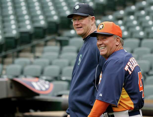 Seattle Mariners third-base coach Jeff Datz, left, and Houston Astros third-base coach Dave Trembley, right, chat during batting practice before a baseball game, Tuesday, April 9, 2013, in Seattle. (AP Photo/Ted S. Warren) Photo: Associated Press / AP