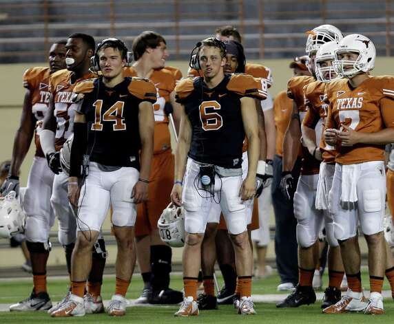Texas quarterbacks David Ash (14) and Case McCoy (6) during the team's spring football game, Saturday, March 30, 2013, in Austin, Texas. (AP Photo/Eric Gay) Photo: Associated Press / AP