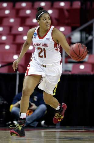 Maryland forward Tianna Hawkins drives the ball during the second half of a first-round game against Quinnipiac in the women's NCAA college basketball tournament in College Park, Md., Saturday, March 23, 2013. (AP Photo/Patrick Semansky) Photo: Associated Press / AP