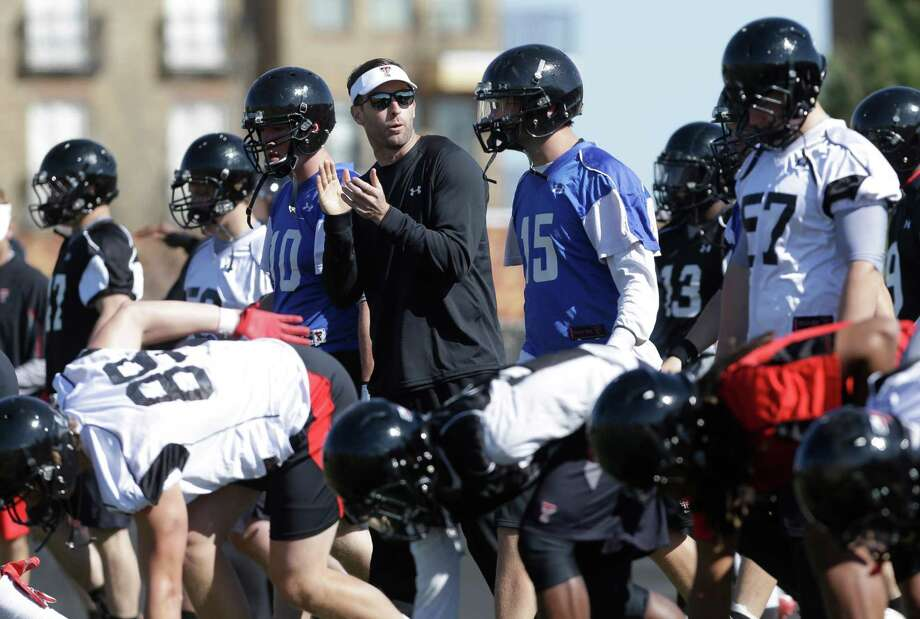 Texas Tech head football coach Kliff Kingsbury claps with his players during spring team football practice in Lubbock, Texas, Sunday, March 24, 2013.  At 33-years-old, the former Texas Tech star quarterback is the youngest head coach of a BCS school heading into his first year as a head coach. (AP Photo/LM Otero) Photo: Associated Press / AP