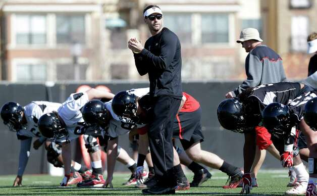 Texas Tech head football coach Kliff Kingsbury walks among players during spring team practice in Lubbock, Texas, Sunday, March 24, 2013.  At 33-years-old, the former Texas Tech star quarterback is the youngest head coach of a BCS school heading into his first year as a head coach. (AP Photo/LM Otero) Photo: Associated Press / AP