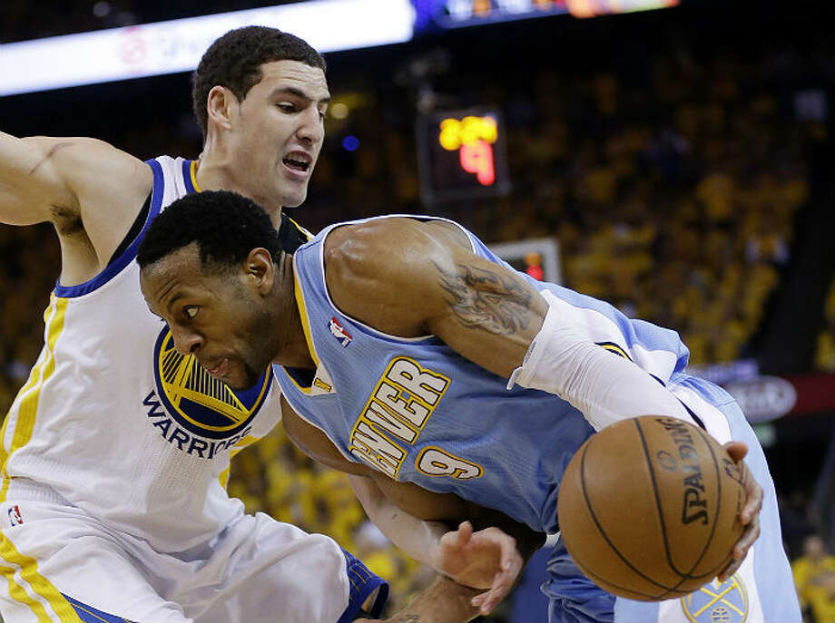 The Warriors' Klay Thompson (left) plays defense on the Nuggets' Andre Iguodala during Game 6 of the first round of the playoffs. Golden State won 92-88. Marcio Jose Sanchez / Associated Press