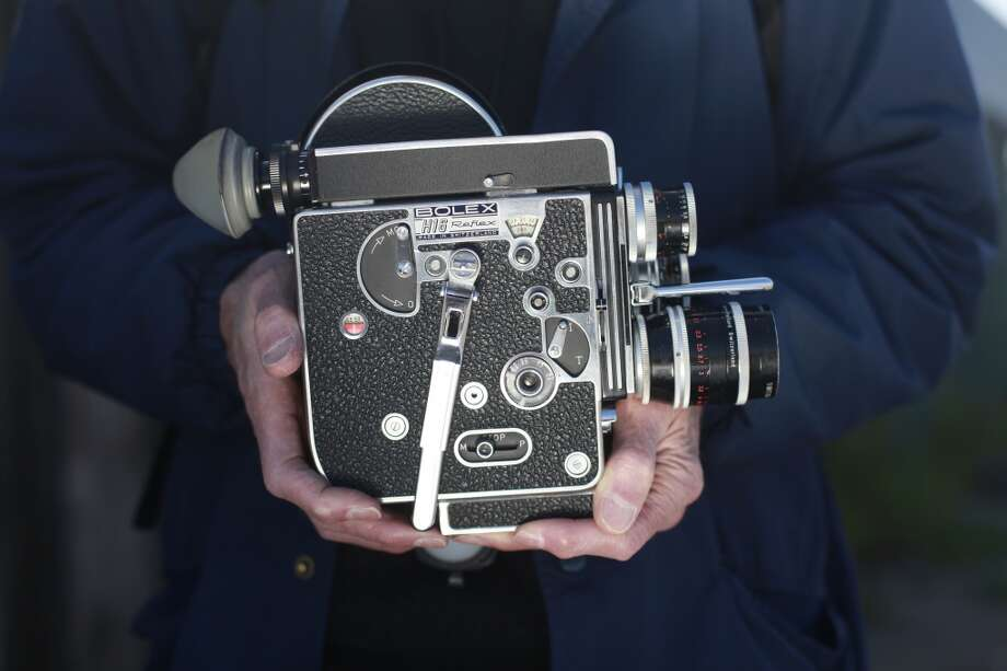 Filmmaker Jerome Hiler holds his vintage Bolex 16mm camera. Hiler started making films and 1964 and has been using similar technology ever since.