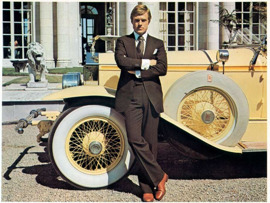 """Robert Redford,  as Jay Gatsby leaning against luxurious car in a scene from the film """"The Great Gatsby,"""" 1974."""