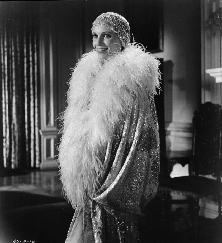 """Mia Farrow as Daisy Buchanan is swathed in elegance as she prepares for a party in a scene from the film """"The Great Gatsby,"""" 1974."""