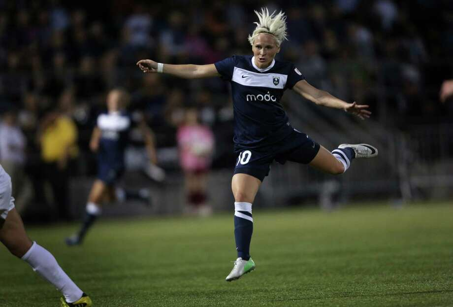 Seattle Reign FC player Jessica Fishlock watches a shot at goal go wide against FC Kansas City during the Reign's first home match on May 4, 2013 at Starfire Sports in Tukwila. Reign FC is Seattle's new women's pro soccer team. They lost to Kansas 0-1. Photo: JOSHUA TRUJILLO, SEATTLEPI.COM / SEATTLEPI.COM