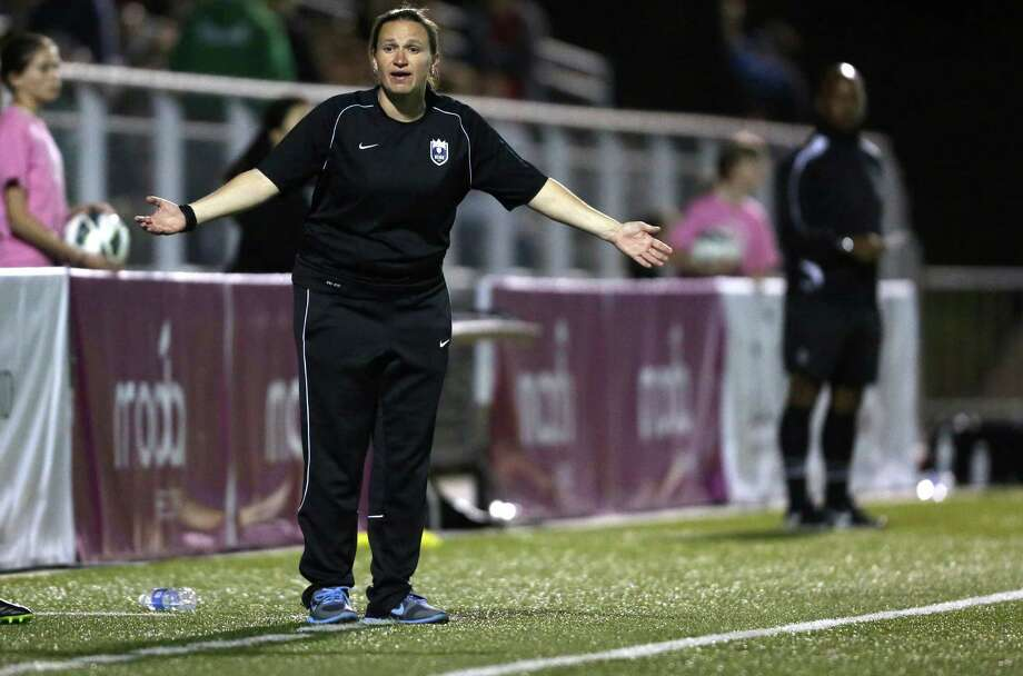 Seattle Reign FC coach Laura Harvey reacts to a call during the Reign's first home match on May 4, 2013 at Starfire Sports in Tukwila. Reign FC is Seattle's new women's pro soccer team. They lost to Kansas 0-1. Photo: JOSHUA TRUJILLO, SEATTLEPI.COM / SEATTLEPI.COM