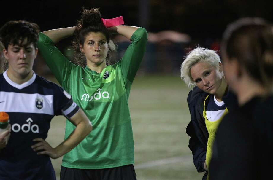 Seattle Reign FC players, from left, Keelin Winters, goalie Michelle Betos, and Jessica Fishlock listen to coach Laura Harvey during the Reign's first home match on May 4, 2013 at Starfire Sports in Tukwila. Reign FC is Seattle's new women's pro soccer team. They lost to Kansas 0-1. Photo: JOSHUA TRUJILLO, SEATTLEPI.COM / SEATTLEPI.COM
