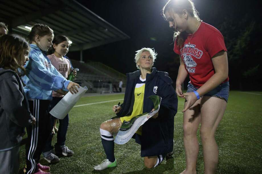 Seattle Reign FC player Jessica Fishlock signs autographs for fans during the Reign's first home match on May 4, 2013 at Starfire Sports in Tukwila. Reign FC is Seattle's new women's pro soccer team. They lost to Kansas 0-1. Photo: JOSHUA TRUJILLO, SEATTLEPI.COM / SEATTLEPI.COM