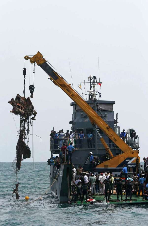 The debris of a Russian built Antonov passenger aircraft is pulled out from sea bottom with the help of a crane during a salvage mission in Iranativu isle, off Mannar cost, about 180 kilometers (113 miles) north of Colombo, Sri Lanka, Saturday, May 4, 2013. Sri Lankan police and navy began salvaging a passenger aircraft , owned by Lion Air, which was gunned down allegedly by Tamil Tiger rebels in 1998, killing 48 civilian passengers on board including two Russian pilots. Photo: AP