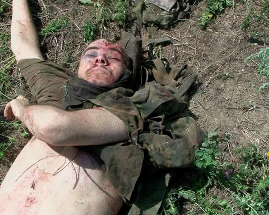 EDS NOTE: GRAPHIC CONTENT In this undated photo provided by the Dagestani branch of the Federal Security Service, the body of William Plotnikov, killed in a standoff with police in Dagestan. Security officials suspected ties between elder Boston bombing suspect Tamerlan Tsarnaev and the Canadian, an ethnic Russian named William Plotnikov, who had joined the Islamic insurgency in the region. Russian agents placed Tsarnaev under surveillance during a six-month visit to southern Russia last year, then scrambled to find him when he suddenly disappeared after police killed a Canadian jihadist, a security official told The Associated Press. Photo: AP
