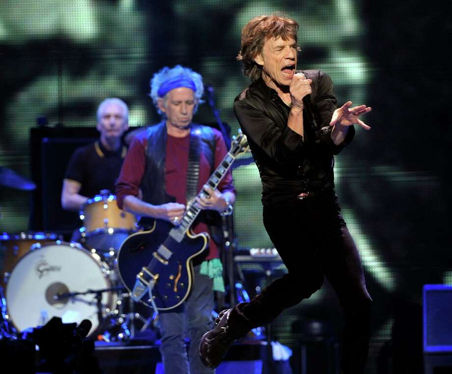 "Mick Jagger, right, Keith Richards, center, and Charlie Watts of the Rolling Stones perform at the kick-off of the band's ""50 and Counting"" tour at the Staples Center on Friday, May 3, 2013 in Los Angeles. Photo: AP"