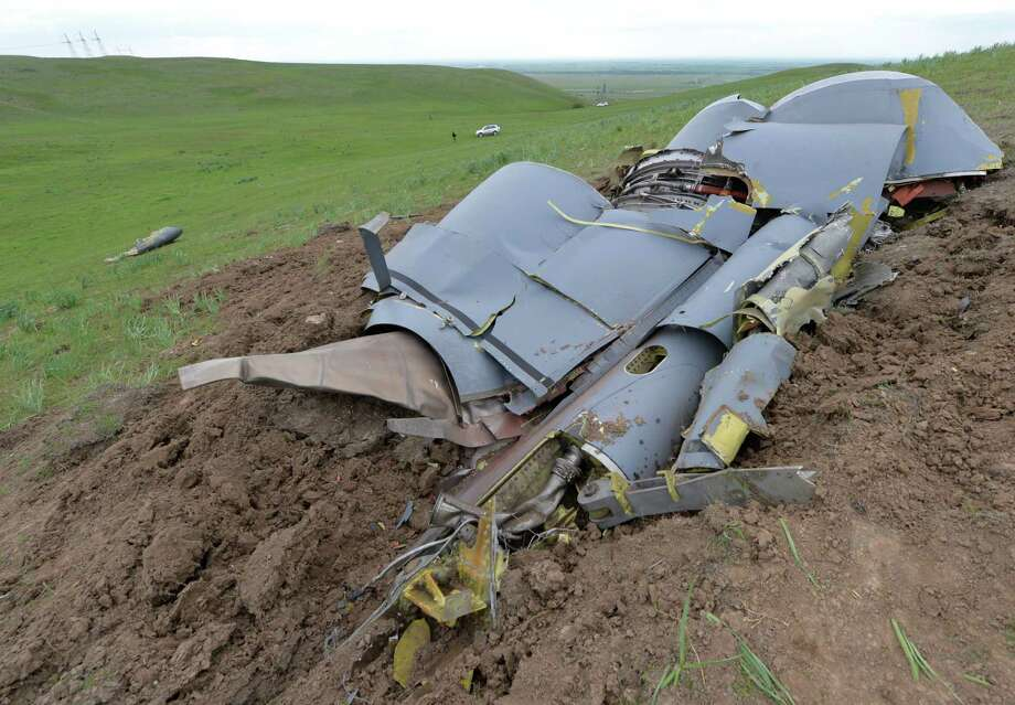 Wreckage from a U.S. Air Force KC-135 tanker aircraft wreckage is strewn across a field near the village of Chaldovar, about 100 miles (160 kms) west of the Kyrgyz capital Bishkek, Friday, May 3, 2013. The emergencies ministry in Kyrgyzstan says a US military plane has crashed in the country. Kyrgyzstan hosts a US base that is used for troops transiting into and out of Afghanistan and for C-135 tanker planes that refuel warplanes in flight. Photo: AP