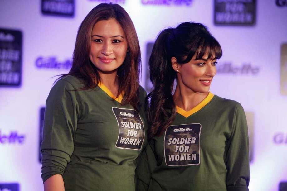 "Indian badminton player Jwala Gutta, left and Bollywood actor Chitrangada Singh pose for the media during a promotional event for ""Soldier for Women"", a campaign that seeks to encourage men to act like soldiers for women in Hyderabad, India, Monday, April 29, 2013. The campaign has been introduced at a time when sexual crimes against women and children are reported every day in the Indian media. Photo: AP"