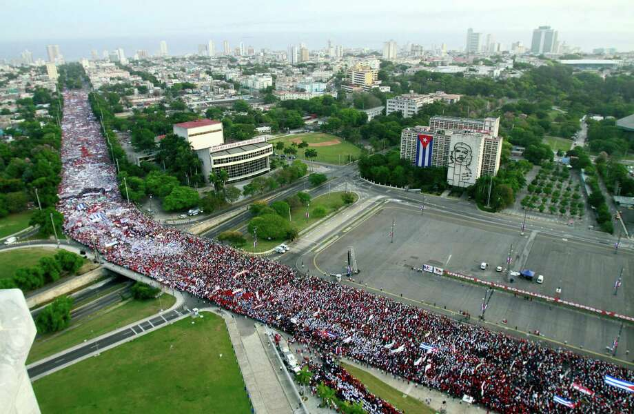 People fill a street during a May Day march to Revolution Square in Havana, Cuba, Wednesday, May 1, 2013. Photo: AP