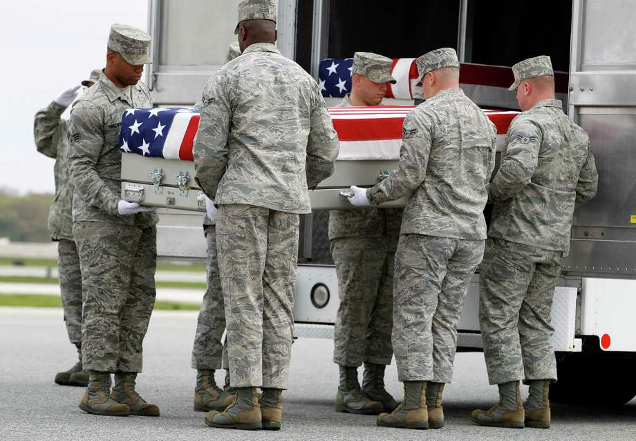 An Air Force carry team, carries the transfer case containing the remains of Air Force Staff Sgt. Daniel N. Fannin of Morehead, Ky., upon arrival at Dover Air Force Base, Del. on Tuesday, April, 30,  2013. The Department of Defense announced the death of Fannin who was supporting Operation Enduring Freedom in Afghanistan. Photo: AP