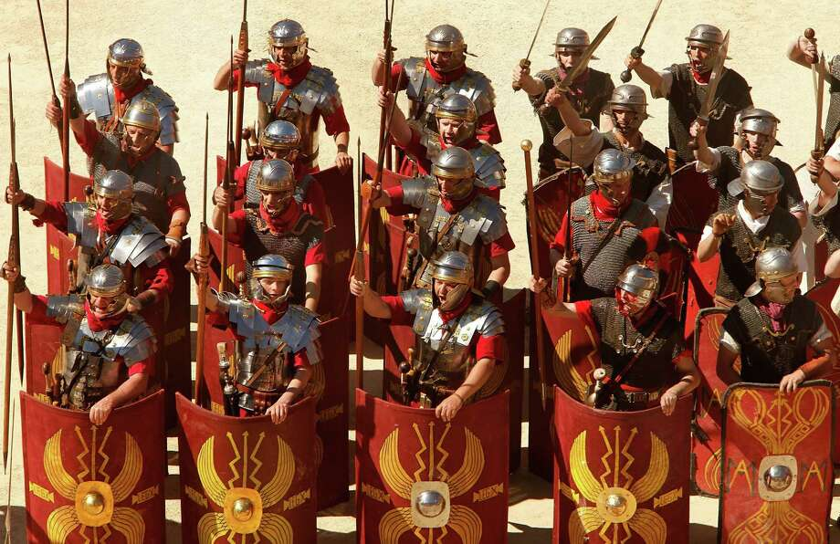 Hundreds of actors from across Europe recreate the Battle of Alesia, where Julius Ceasar, with Mark Antony,  and Roman battalions fought against Gaul troops around 52 BCE during the Gallic Wars, during the 4th Great Roman Games on May 4, 2013 in Nimes, France. Photo: Patrick Aventurier, Getty / 2013 Patrick Aventurier