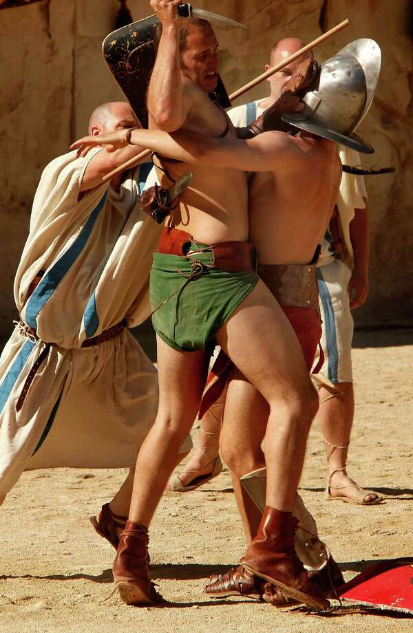 Actors participate in the historic recreation of the Battle of Alesia, where Julius Ceasar, with Mark Antony,  and Roman battalions fought against Gaul troops around 52 BCE during the Gallic Wars, during the 4th Great Roman Games on May 4, 2013 in Nimes, France. Photo: Patrick Aventurier, Getty / 2013 Patrick Aventurier