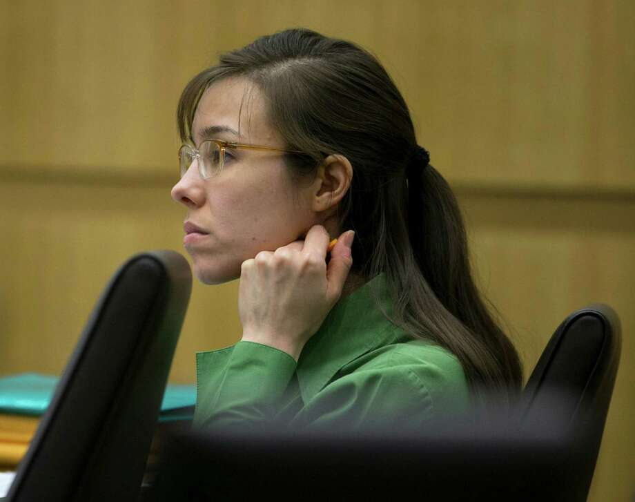 Defendant Jodi Arias listens as Dr. Janeen DeMarte, an expert witness for the prosecution,  is cross examined during her trial at Maricopa County Superior Court in Phoenix on Wednesday, April 17, 2013.   Arias is on trial for the killing of her boyfriend, Travis Alexander in 2008.  Arias claims self-defense but faces a potential death sentence if convicted of first-degree murder. Photo: AP