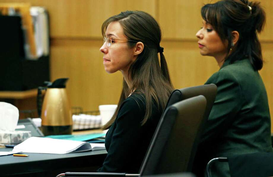 Defendant Jodi Arias, center, listens to defense attorney Kirk Nurmi make his closing arguments during her trial on Friday, May 3, 2013 at Maricopa County Superior Court in Phoenix.  Arias is charged with first-degree murder in the stabbing and shooting death of Travis Alexander, 30, in his suburban Phoenix home in June 2008. Photo: AP
