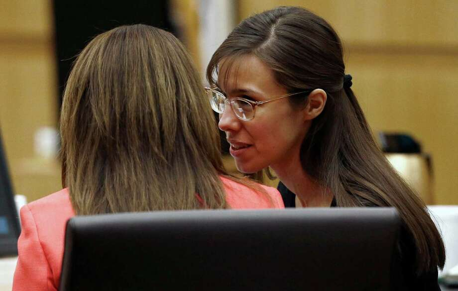 Defense attorney Jennifer Wilmott listens to defendant Jodi Arias, right, as lead defense attorney Kirk Nurmi make his closing arguments  during her trial Friday, May 3, 2013 at Maricopa County Superior Court in Phoenix.  Arias is charged with first-degree murder in the stabbing and shooting death of Travis Alexander, 30, in his suburban Phoenix home in June 2008. Photo: AP